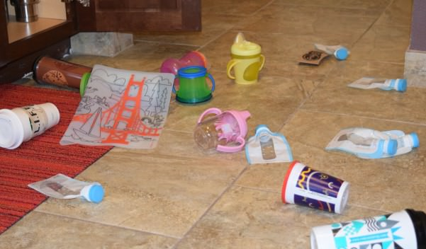 The scene in our kitchen after our daughter played in her kid cabinet