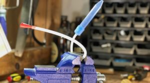 The NoseFrida in a vice grip in a workshop