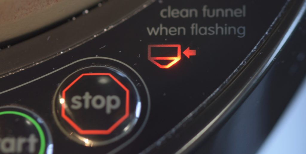 The 'clean when flashing' light on the Baby Brezza Formula Pro