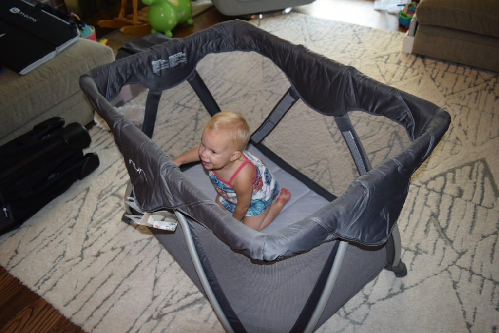 A toddler in a graphite Nuna Sena Aire