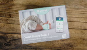 Owlet Smart Sock 2 in box on a wooden table