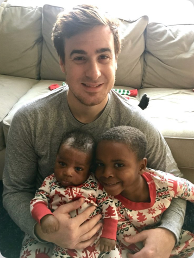 Father holding two children in his lap
