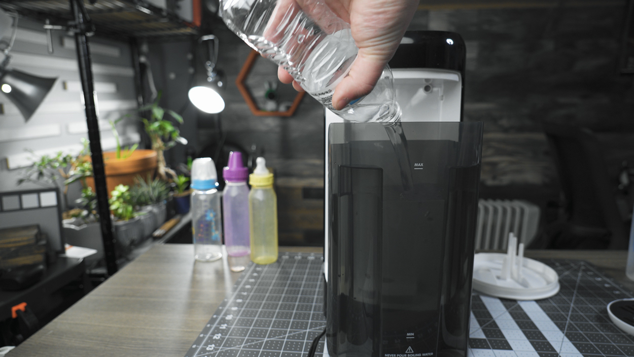 Pouring water into the tank of the Formula Pro Advanced